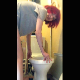 A girl with red dyed hair stands precariously over her toilet while spreading her ass cheeks and taking a shit. Presented in 720P vertical HD format. Over 1.5 minutes.
