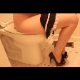 A woman wearing high heels sits down on a toilet and has a noisy dump with farts and wet poop sounds.