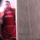 A woman is video-recorded taking a shit by a hidden camera mounted behind a floor toilet. You can tell that this is definitely Eastern-European by the look of bundled up woman entering the restroom.