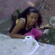 A girl is taking a piss and a shit outside on the ground, when all of a sudden, her friend surprises her with a video camera!