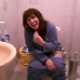 A French girl is video-recorded singing while taking a shit on the toilet. No audible poop sounds.