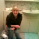A blonde girl is seen shitting while sitting on a toilet. She then wipes her ass and moons for the camera. Unfortunately, the person filming puts her hand over the lens during the best parts.