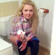A beautiful Scottish girl is seen sitting on a toilet after taking her shit. She is visibly upset by being video-recorded and chases the videographer out of the bathroom. Complaints about the smell are heard.
