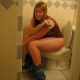 A girl is video-recorded as she tries to shit while others laugh nearby. No pooping sounds, but the girl has a nice, pudgy bottom.