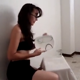 A brunette woman wearing glasses appears to be preparing a dinner by taking a massive, heaping shit on a plate and pissing into a glass. About 3 minutes.