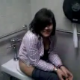 A girl is video-recorded in a public restroom at a Seven-Eleven store. Peeing is audible, and she even puts on a nice singing performance. Over 2 minutes.