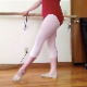 A plump ballerina stops her dance practice to take a piss and shit in her leotards. We get to watch a dark bulge growing under her tights, but she does not pull the pants down, probably to save herself the cleanup. Over 7 minutes.