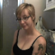 A cute, blonde girl with short hair, tattoos and glasses talks to the camera as she takes a shit while sitting on a toilet. Finished product shown. This would have been a great video if frame rate was faster and audio was in sync. Over 10.5 minutes.