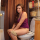 A brunette girl rushes to the toilet, sits down and takes a loose-sounding shit while wearing shorts. Presented in 720P HD video. About 3 minutes.