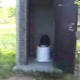 We are shown a heavily used outhouse in a park that is filled with turds and toilet paper from previous visitors. Next, we get to see a woman add her fresh one to the stinking pile.