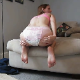 A skinny girl takes a shit while wearing a diaper. She removes the diaper and cleans her filthy ass. Over 7 minutes.