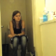 A hidden camera set up in a bathroom records a pretty girl taking a shit that comes out with a squeaking sound shortly after she sits down on the toilet. She also takes a long piss and appears very sleepy. About 5.5 minutes.