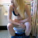 A pretty, soft-spoken blonde girl on her period records herself pulling out a tampon and taking a shit while sitting on a toilet. She wipes her ass and period blood, then shows us her finished product. Over 6 minutes.