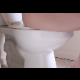 A woman sits down on a toilet and has a noisy dump with farts and wet poop sounds. This scene features an up-close perspective for added intimacy.