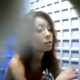 A Japanese girl is observed through multi-angle cameras as she smokes while taking a shit into a floor toilet.