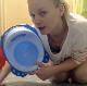 Sophie, a blonde girl from Poland, tells us in English that she does not want to use her regular toilet today. She proceeds to take a big shit in a plastic baby potty instead. Finished product and mess clearly shown. 720P HD. Over 9 minutes.