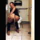 A black girl takes a shit onto the floor in a public restroom stall. She wipes her ass when finished. Presented in 720P vertical HD format. About a minute.