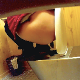 A hidden camera records an unsuspecting woman squatting on top of a steel toilet in a public restroom while pissing and shitting. Presented in 720P HD. 176MB, MP4 file. About 5 minutes.