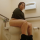 Veronica was in line at the bank when the urge to poop hit her hard. We follow her to the bathroom and watch her stink up the place. Way to go! Show those banksters. Nice audible plops and wet farts. No poop shown. Presented in 720P HD. About 4 minutes.