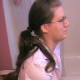 A studious-looking girl wearing glasses and with a New Jersey accent is recorded taking a wet-sounding shit while sitting on a toilet. She complains about the smell and then wipes her ass. The woman filming cuts a loud fart, too. Over 4 minutes.