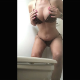 A slender woman wearing only a swimsuit takes a wide, hard, knobby shit while bending over in front of a toilet. Vertical format video. Over a minute.