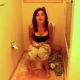 A brief video clip of a brunette girl pooping on a toilet and in need of wiping her ass.