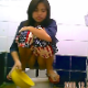 A very pretty Thai girl is recorded by a hidden camera as she takes a highly visible, large shit while squatting over a public floor toilet. She uses a bowl of water to flush and clean herself. About a minute.