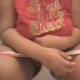 A fat girl with a big butt poops while sitting on a toilet from a semi-side position. No poop is visible, but video is smooth, and audio is good.