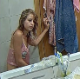 A hidden camera is positioned to record the reflection in the bathroom mirror of an attractive blonde girl pissing, farting and shitting while sitting on a toilet in several scenes. Some bonus sleep farting scenes afterwards. Over 5 minutes.