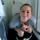 A British girl is filmed pooping on a toilet by her friend. The scene is brief, and no pooping sounds can be heard.