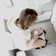 A compilation of 5 brief, low-quality voyeur scenes of women peeing and wiping themselves - as filmed from over the stall wall of a public restroom.