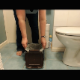 An older British woman records herself taking a shit into her bathroom trash can. She wipes her ass and prepares the trash bag for proper disposal. No product shown. About 3 minutes.