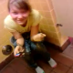 A girl pisses into a trash can because all of the toilets are occupied. Very brief video.