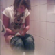 A hidden camera in a bathroom records a young woman farting, peeing, and then trying unsuccessfully to poop.
