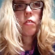 A blonde girl wearing glasses records her ugly facial expressions as she takes a shit sitting on a toilet. Plopping sounds can be heard, but no action or product is shown. See movie 8893 and 8448 for more. About a minute.