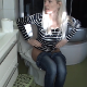 An attractive, blonde, mature woman takes a shit while sitting on a toilet. We can hear many plops that seem to keep coming out of her ass forever. About 3 minutes.