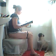 A girl takes a shit while sitting on a toilet (no audible poop sounds). She realizes that there is no toilet paper, so she asks her dog to fetch some. She ends up having to get it herself.