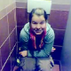 An Eastern-European girl is video recorded pooping while sitting on a toilet in a public restroom. Although the language may sound foreign to you, the plopping sounds will sound quite clear & familiar!