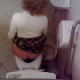 The daring pervert cameraman loses his cool when video recording this curly-haired blonde girl peeing & pooping on the toilet. Something spooks him, and he gets out of there fast, but we still hear some good plops.