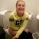 Some German girls record their friend using a toilet in a public restroom. We are not sure if she is peeing or pooping.