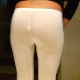 A woman pisses and shits in her tight, white leggings, making some nice crackling sounds in the process. She pulls down the messy pants, and her shit falls out onto the floor. Presented in 720P HD quality.