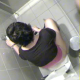 An unseen cameraman is a little late in attempting to video record a woman pooping on a toilet, but we get to watch her wipe her ass.