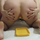 A plump, European girl takes a shit into a yellow plastic tray on the floor. She also poops out 2 plastic balls that must have been inserted into her ass earlier. Presented in 720P HD. About 3.5 minutes.