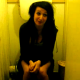 A girl is filmed sitting on a toilet. Maybe she is pooping, maybe not?